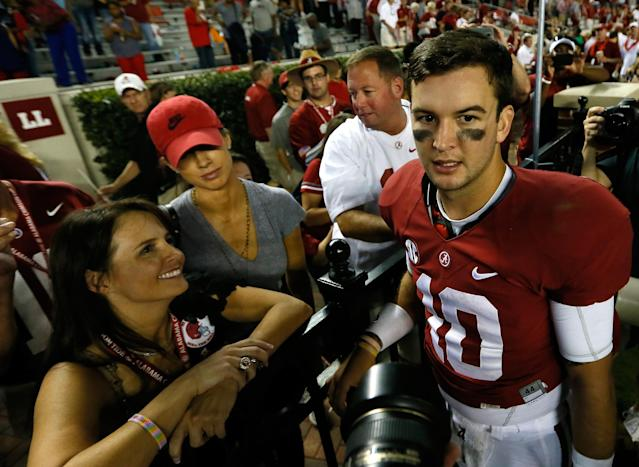 TUSCALOOSA, AL - SEPTEMBER 28: AJ McCarron #10 of the Alabama Crimson Tide is congratulated by (L-R) his mother Dee Dee Bonner, his girlfriend Katherine Webb, and father Tony McCarron after their 25-0 win over the Mississippi Rebels at Bryant-Denny Stadium on September 28, 2013 in Tuscaloosa, Alabama. (Photo by Kevin C. Cox/Getty Images)