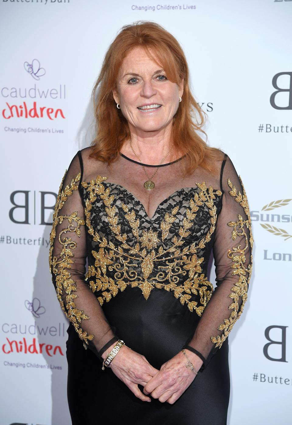 Sarah Ferguson wore a black and gold sheer gown to the Butterfly Ball