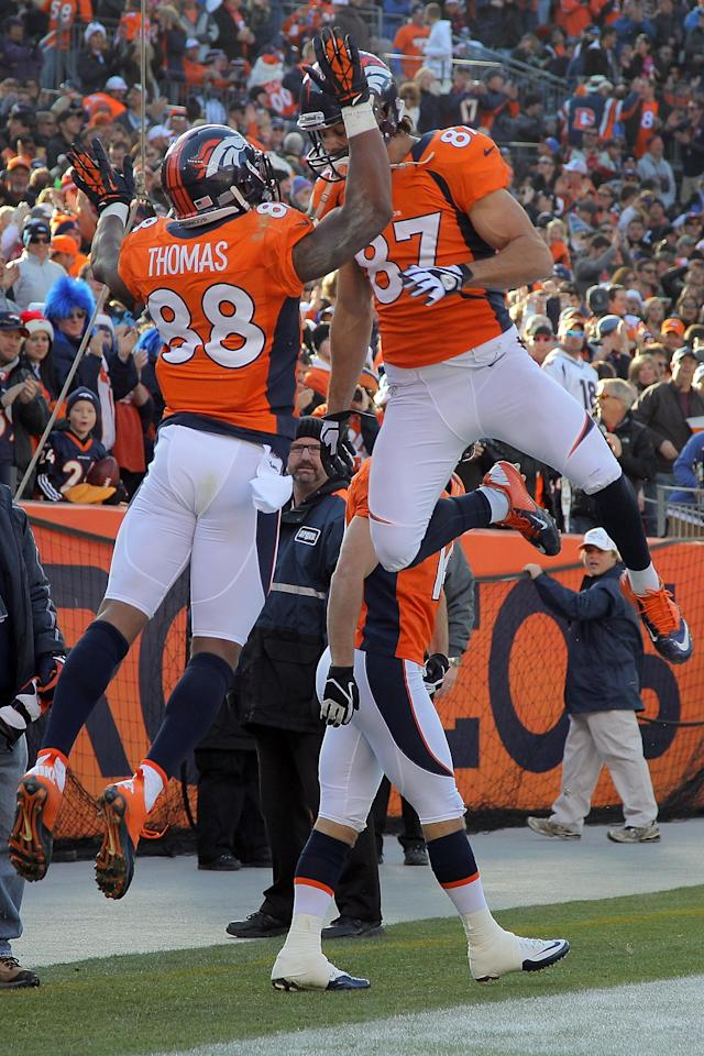 DENVER, CO - DECEMBER 23: Wide receiver Demaryius Thomas #88 of the Denver Broncos celebrates his 22 yard touchdown reception with wide receiver Eric Decker #87 of the Denver Broncos in the first quarter against the Cleveland Browns at Sports Authority Field at Mile High on December 23, 2012 in Denver, Colorado. (Photo by Doug Pensinger/Getty Images)
