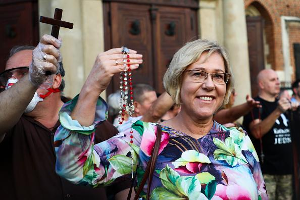 Barbara Nowak, the education superintendent in the Malopolska voivodeship, prays the rosary in front of St Mary's Basilica during an anti-LGBT gathering at the Main Square in Krakow, Poland.