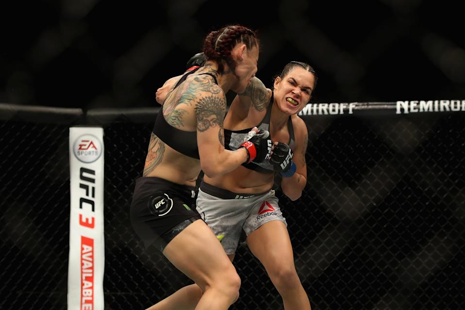 "Amanda Nunes cracks Cris ""Cyborg"" Justino with a right hand during their bout at UFC 232 in December. Nunes will defend her women's bantamweight title on July 6 against Holly Holm in Las Vegas. (Getty Images)"