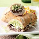 """<p>A Mexican-style torta is just like a burrito, except the """"wrapper"""" is a hollowed-out roll instead of a tortilla. Here it's filled with mashed spiced black beans and a quick guacamole. Take this vegetarian version to another level (and add calcium) by melting Monterey Jack cheese onto the bean side of the sandwich. Serve with: Grilled corn on the cob or Spanish rice. <a href=""""https://www.eatingwell.com/recipe/249726/tijuana-torta/"""" rel=""""nofollow noopener"""" target=""""_blank"""" data-ylk=""""slk:View Recipe"""" class=""""link rapid-noclick-resp"""">View Recipe</a></p>"""
