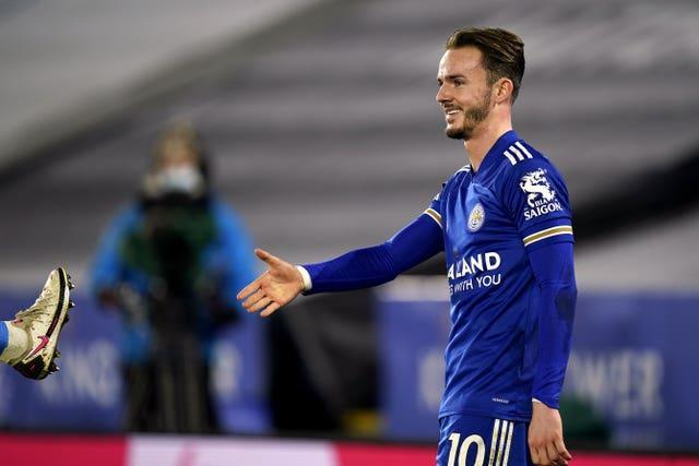 James Maddison pretends to shake hands after scoring Leicester's opener