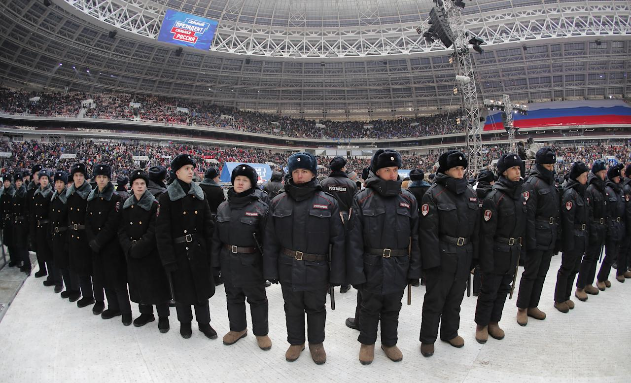 <p>Police guard during a rally to support Russian President Vladimir Putin in the upcoming presidential election at Luzhniki Stadium in Moscow, Russia, March 3, 2018. (Photo: Maxim Shemetov/Reuters) </p>