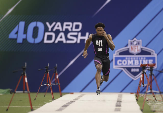 Denzel Ward, an Ohio State cornerback who was drafted by the Browns, runs the 40 at the 2018 scouting combine. (AP)
