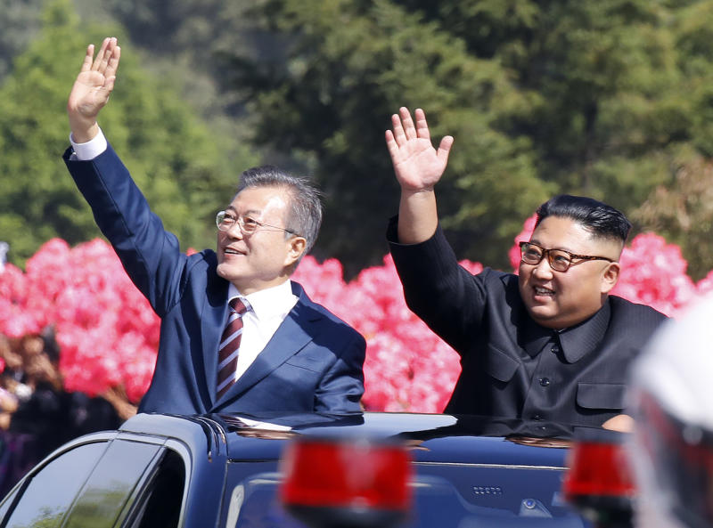 In this Tuesday, Sept. 18, 2018, file photo, South Korean President Moon Jae-in, left, and North Korean leader Kim Jong Un wave from a car during a parade through a street in Pyongyang, North Korea. (Pyongyang Press Corps Pool via AP, File)