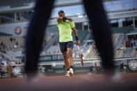 Spain's Rafael Nadal walks back to the service line as he plays against Italy's Jannik Sinner during their fourth round match on day 9, of the French Open tennis tournament at Roland Garros in Paris, France, Monday, June 7, 2021.(AP Photo/Christophe Ena)