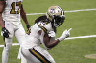 New Orleans Saints running back Alvin Kamara (41) reacts after his fifth touchdown of the game, in the second half of an NFL football game against the Minnesota Vikings54 in New Orleans, Friday, Dec. 25, 2020. (AP Photo/Butch Dill)