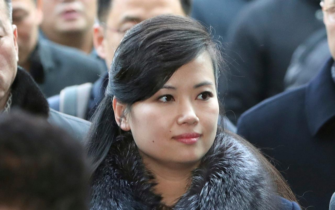 """She leads North Korea's answer to the """"Spice Girls"""", was rumoured to have been Kim Jong-un's girlfriend, and was reportedlyexecuted by firing squad. Having been the subject of such fevered speculation for years, Hyon Song-wol was greeted by a barrage of camera flashes as she arrived in Seoul on Sunday.  The head of the Moranbong Band,the hugely popular North Korean girl band hand-picked by leader Kim Jong-Un,crossed the heavily fortified border into South Korea to check preparations for an art troupe she also leads during next month's Winter Olympics. Appearing live on South Korean television,Hyon made no comment as she walked past a throngof reporters and onlookers before boarding an express train at Seoul's railway station for the eastern city of Gangneung, where her art troupe is to perform during the Pyeongchang Olympics. The singer has been the subject of intense South Korean media attention since she attended last week's talks at the border that struck a deal on the art troupe's two performances - one in Seoul and the other in Gangneung. North Korean Hyon Song Wol, head of a North Korean art troupe, gets off a bus as she arrives at the Seoul Train Station Credit: AP Yet Hyon's present status as a quasi diplomat comes after a colourful past. Intelligence agencies believed she and Mr Kimbecame romantically involved around 2002, after Mr Kim returned home from studying at an elite private academy in Switzerland. Mr Kim was later said to havebeen ordered by his father Kim Jong-il to break off his relationship. She went on to marry an officer in the North Korean army with whom she had a baby. North Korea's Moranbong Band, an all-female ensemble that was hand-picked by leader Kim Jong-un Credit: AP She made a return to the limelight in early 2012 when she performed at an event in Pyongyang to mark International Women's Day, which was attended by Mr Kim. """"The two have known each other since they were in their teens and rumours about the two having an affair have been"""