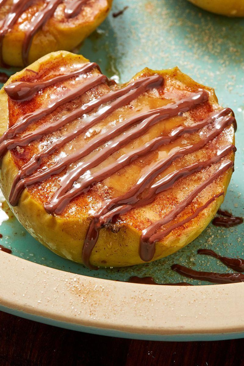 """<p>Apples get coated in cinnamon sugar, then baked with caramel candies and finally topped off with healthy chocolate drizzle. Serve these warm with a scoop of vanilla ice cream for an extra indulgent dessert. </p><p>Get the <a href=""""https://www.delish.com/uk/cooking/recipes/a33120519/caramel-stuffed-apples-recipe/"""" rel=""""nofollow noopener"""" target=""""_blank"""" data-ylk=""""slk:Caramel Stuffed Apples"""" class=""""link rapid-noclick-resp"""">Caramel Stuffed Apples</a> recipe.</p>"""