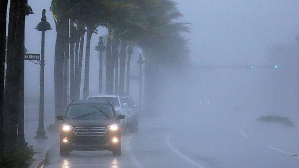PHOTO:Cars move along highway A1A  with poor visability in Fort Lauderdale, Fla., Nov. 8, 2020. (Joe Cavaretta/AP)