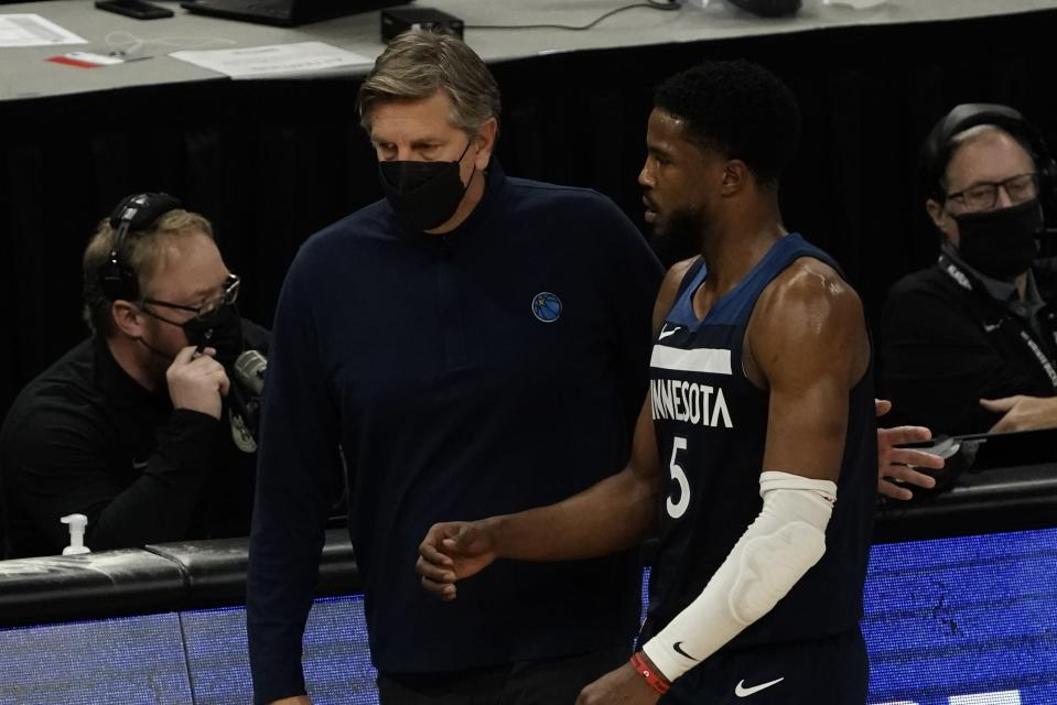 Minnesota Timberwolves head coach Chris Finch talks to Malik Beasley during the first half of an NBA basketball game against the Milwaukee Bucks Tuesday, Feb. 23, 2021, in Milwaukee. (AP Photo/Morry Gash)