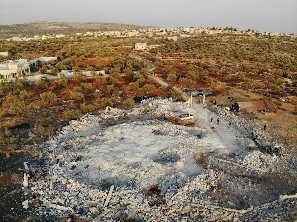 """An aerial view taken on October 27, 2019 shows the site that was hit by helicopter gunfire which reportedly killed nine people near the northwestern Syrian village of Barisha in the Idlib province along the border with Turkey, where """"groups linked to the Islamic State (IS) group"""" were present, according to a Britain-based war monitor with sources inside Syria. - The helicopters targeted a home and a car on the outskirts of Barisha, the Syrian Observatory for Human Rights said, after US media said IS leader Abu Bakr al-Baghdadi was believed to be dead following a US military raid in the same province. Observatory chief Rami Abdel Rahman said the helicopters likely belonged to the US-led military coalition that has been fighting the extremist group in Syria. (Photo by Omar HAJ KADOUR / AFP) (Photo by OMAR HAJ KADOUR/AFP via Getty Images)"""