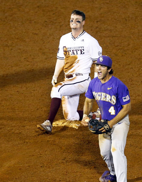 LSU shortstop Josh Smith (4) reacts after tagging Mississippi State's Tanner Allen (5) out at second base during the 15th inning of the Southeastern Conference tournament NCAA college baseball game, early morning Thursday, May 23, 2019, in Hoover, Ala. (AP Photo/Butch Dill)