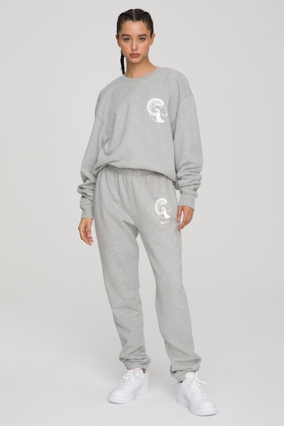 Koutrney Kardashian posed in the Aries Boyfriend Sweatshirt ($124) and Sweatpants  ($105) combo from Good American.
