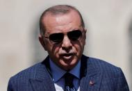 FILE PHOTO: Turkish President Tayyip Erdogan talks to media after attending Friday prayers at Hagia Sophia Grand Mosque in Istanbul