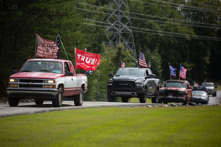 Trucks gather for a Trump rally in Elon, N.C. A few Latinos who support Trump attended.