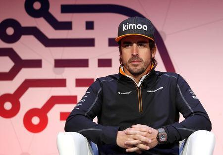 Fernando Alonso of McLaren delivers a keynote speech during the Mobile World Congress in Barcelona, Spain February 27, 2018. REUTERS/Yves Herman