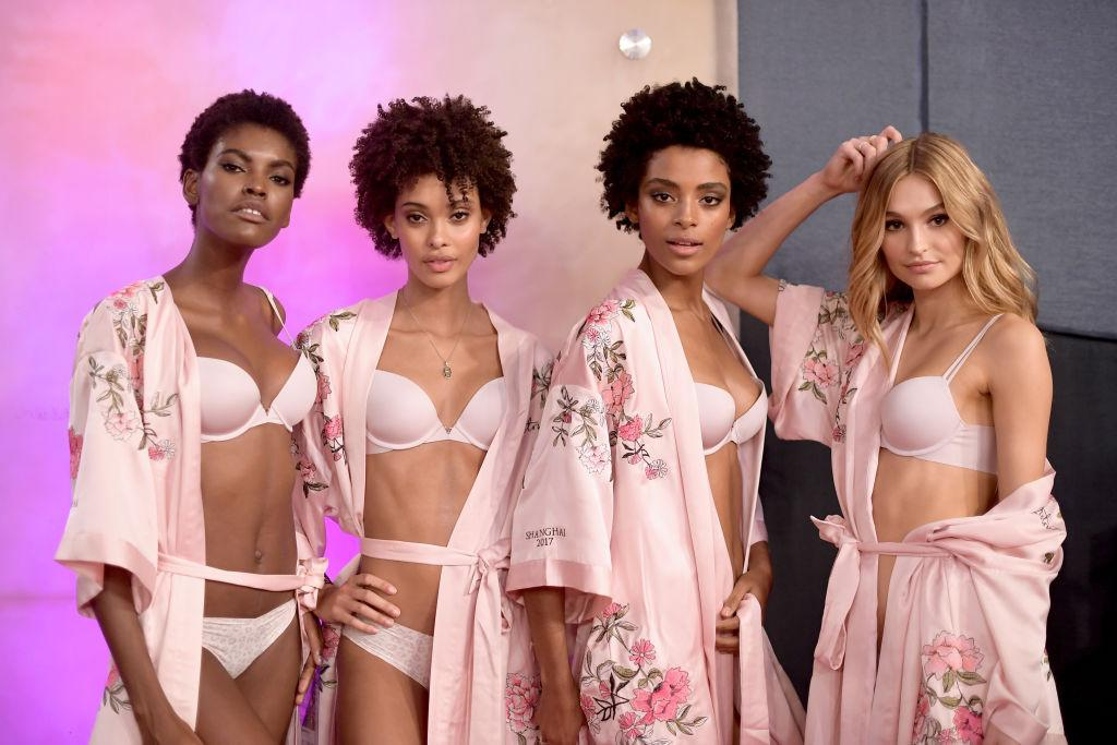 <p>Models Maria Borges, Samile Bermannelli, Alecia Morais and Frida Aasen pose together in co-ordinating floral kimonos ahead of the show. <em>[Photo: Getty]</em> </p>