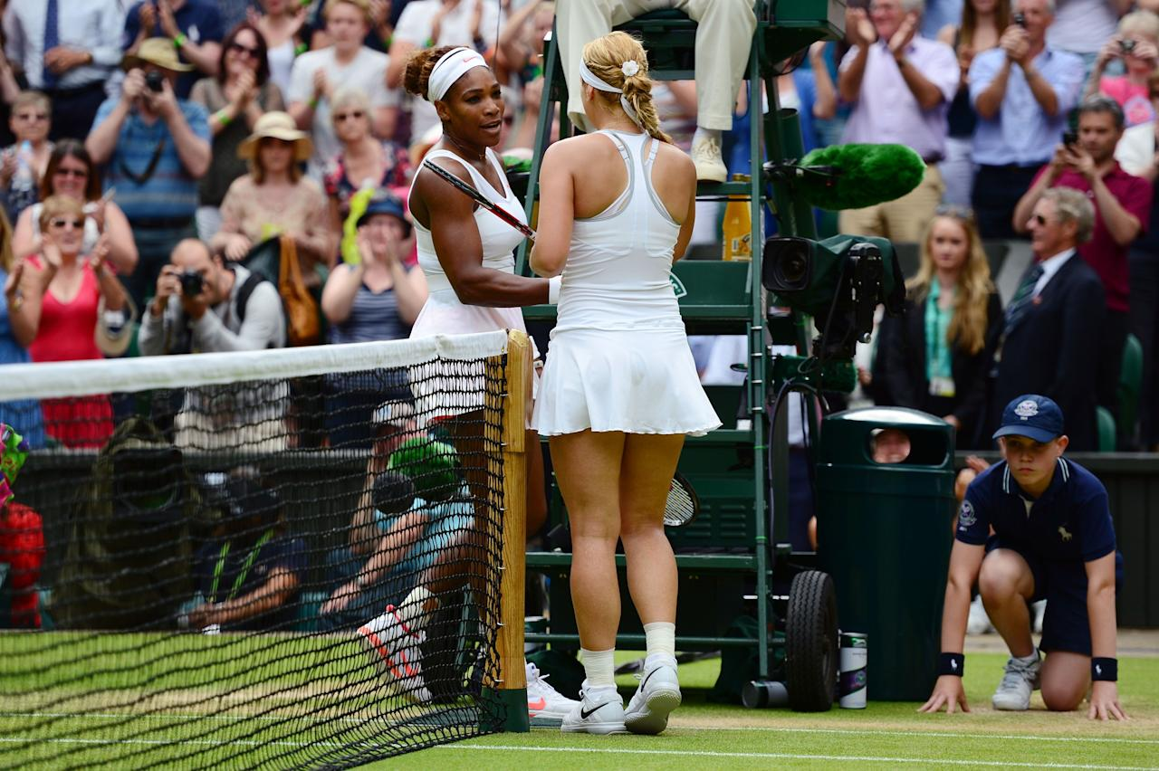 LONDON, ENGLAND - JULY 01: Sabine Lisicki of Germany shakes hands at the net with Serena Williams of United States of America after their Ladies' Singles fourth round match on day seven of the Wimbledon Lawn Tennis Championships at the All England Lawn Tennis and Croquet Club on July 1, 2013 in London, England. (Photo by Mike Hewitt/Getty Images)