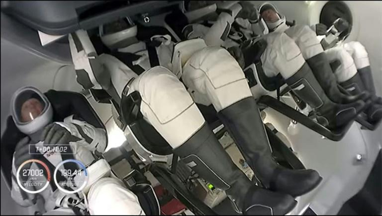 This SpaceX video grab shows Nasa's SpaceX Crew-1 members waiting for 2nd Stage separation, (from L) Shannon Walker, Victor Glover, Michael Hopkins and Soichi Noguchi, on November 15, 2020 after launching from NASA's Kennedy Space Center in Florida