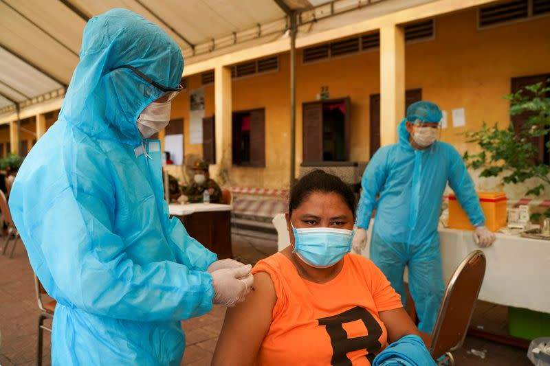 Cambodian army members vaccinate people in Phnom Penh