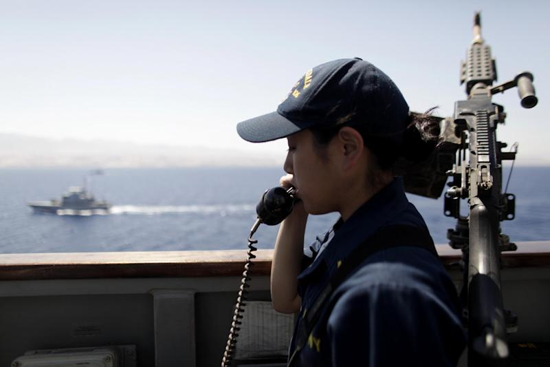 U.S. Navy Ensign Shin Knoll watches a Jordanian patrol craft from aboard the USS Stockdale during maneuvers with the Jordanian Navy in the Gulf of Aqaba, Jordan as part of Eager Lion, a multinational military exercise, Tuesday, June 18, 2013. Under the watchful eye of stern-faced American advisers, hundreds of U.S.-trained Jordanian soldiers are holding war games that could eventually form the basis of an assault in Syria. There is fear of spillover from the Syrian war in this U.S.-allied kingdom, and the potential for a Jordanian role in securing Syria's chemical stockpiles should Bashar Assad's regime lose control. (AP Photo/Maya Alleruzzo)