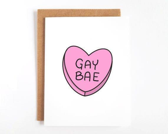 """<p><strong>littlerainbowpaperco</strong></p><p>etsy.com</p><p><strong>$7.50</strong></p><p><a href=""""https://go.redirectingat.com?id=74968X1596630&url=https%3A%2F%2Fwww.etsy.com%2Flisting%2F769744469%2Fcute-gay-love-cards-lgbt-valentines&sref=https%3A%2F%2Fwww.goodhousekeeping.com%2Fholidays%2Fvalentines-day-ideas%2Fg35002334%2Flgbtq-valentines-day-cards%2F"""" rel=""""nofollow noopener"""" target=""""_blank"""" data-ylk=""""slk:Shop Now"""" class=""""link rapid-noclick-resp"""">Shop Now</a></p><p>Even if you can't find candy hearts with your chosen sentiment, you can send this adorable card that features one. It's blank inside so you can pen your own perfect message.</p>"""