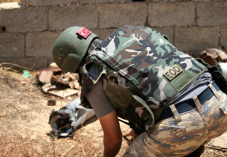 A Turkish deminer takes part in the clearance of unexploded ordnance south of the Libyan capital Tripoli on June 15