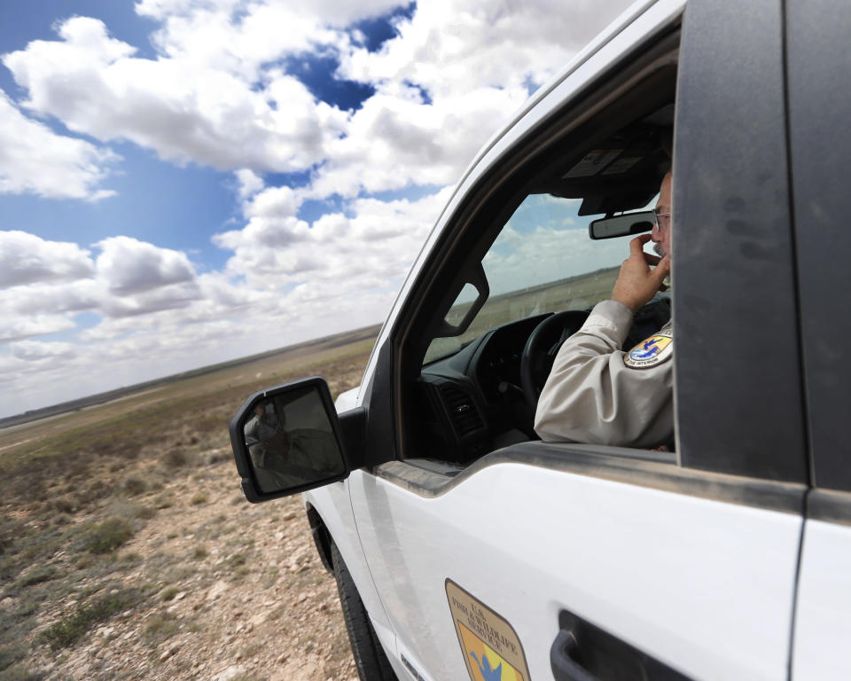 """Jude Smith, a biologist at the Muleshoe National Wildlife Refuge outside Muleshoe, Texas, looks over dry native prairie on Tuesday, May 18, 2021. The U.S. Department of Agriculture is encouraging farmers in a """"Dust Bowl zone"""" that includes parts of Texas, New Mexico, Oklahoma, Kansas and Colorado to preserve and establish grasslands, which can withstand drought. (AP Photo/Mark Rogers)"""