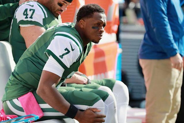 Geno Smith rests his ailing knee on Sunday. (Getty Images)