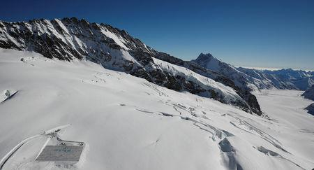 A general view shows 100,000 postcards (bottom L) with messages against climate change, sent by young people from all over the world and stuck together to break the Guinness World Record of the biggest postcard, on the Jungfraufirn, the upper part of Europe's longest glacier, the Aletschgletscher, near Jungfraujoch, Switzerland November 16, 2018. REUTERS/Arnd Wiegmann