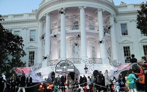 U.S. President Donald Trump (L) and first lady Melania Trump host Halloween at the White House on the South Lawn October 30, 2017 in Washington, DC - Credit: Getty