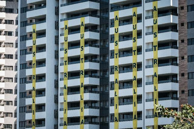 Banners of Australia are displayed at the apartments for the Australian Olympic team during the opening ceremony of the Olympic Village in Rio de Janeiro, Brazil, on July 24, 2016 (AFP Photo/Yasuyoshi Chiba)