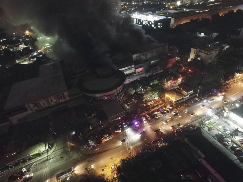Smoke billows from a mall as it catches fire shortly after a strong earthquake struck General Santos city, South Cotabato province, southern Philippines on Wednesday Oct. 16, 2019. A powerful and shallow earthquake hit several southern Philippine provinces Wednesday night injuring some people in collapsed houses and prompting thousands to scramble out of homes, shopping malls and a hospital in panic, officials and news reports said. Officials also added that it was still unclear if the fire was sparked by the temblor. (AP Photo/Allan Jay Resane)