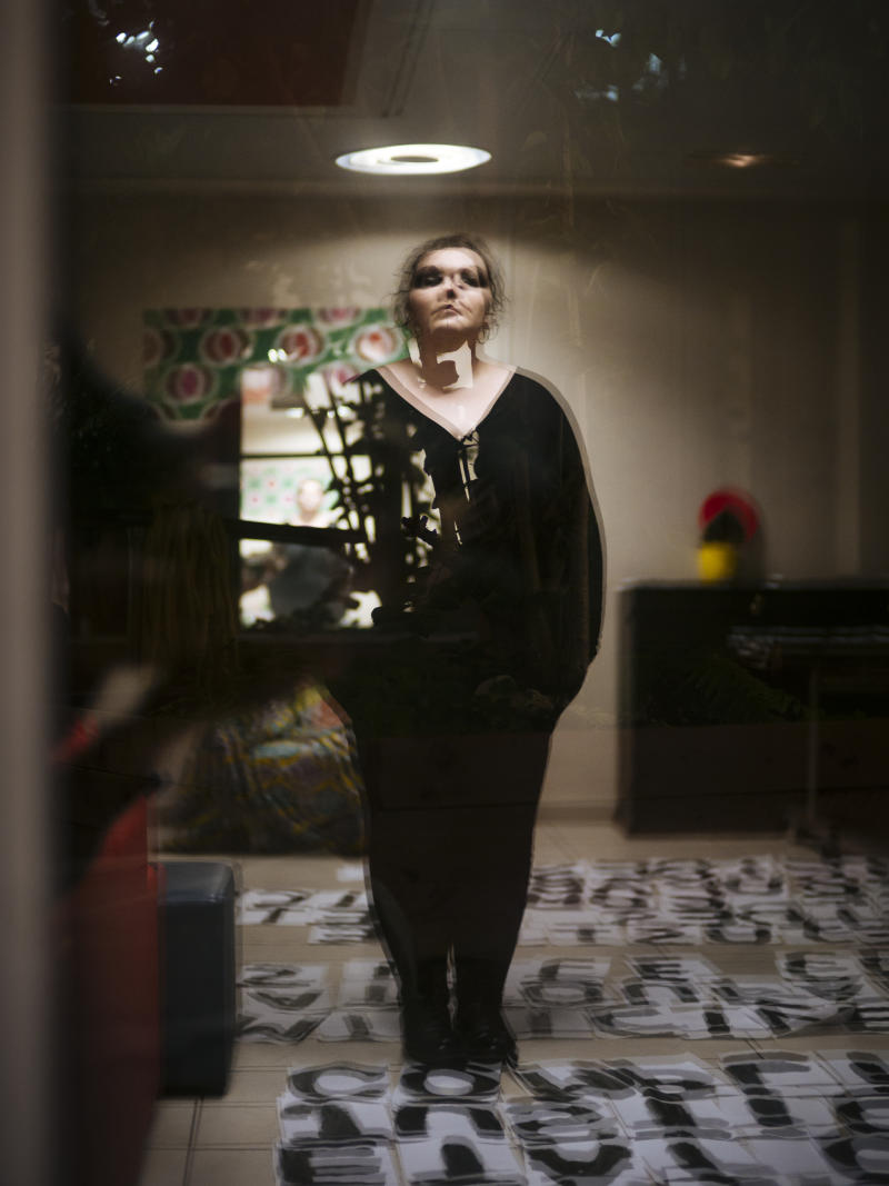 Mathilde, 35, a musician from Paris, is reflected in a window as she poses for a portrait in Paris. After Mathilde experienced domestic violence when she was 20 years old, she feels today like a survivor. The police's inaction in her case, propelled her to become an activist by pasting signs in the streets. (Photo: Kamil Zihnioglu/AP)