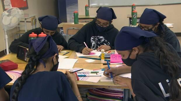 Students at Surrey's Khalsa School prepare for an online art auction to support COVID-19 relief in India.  (Shawn Foss/CBC News - image credit)