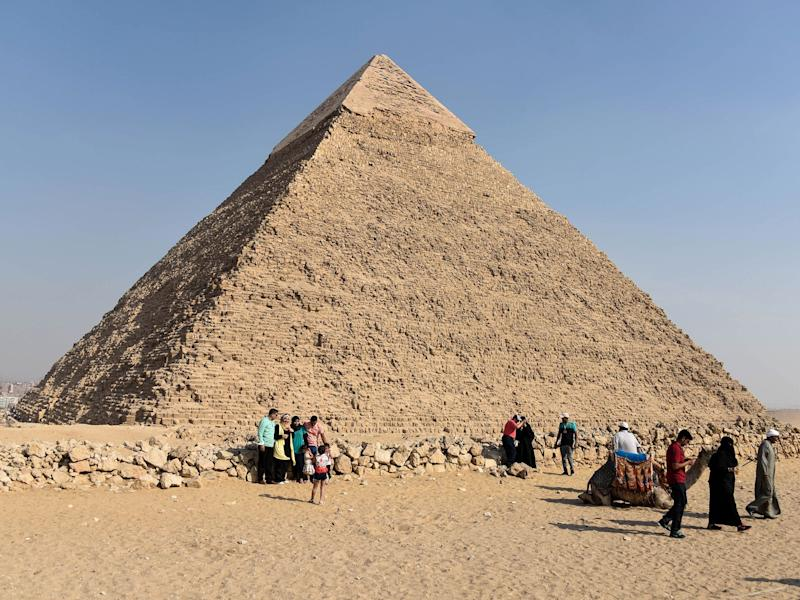 Tourists visit the Giza pyramids, on the southern outskirts of the Egyptian capital, Cairo: AFP/Getty