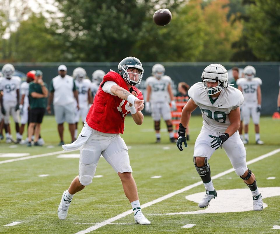 Michigan State quarterback Anthony Russo (15) makes a pass during practice Wednesday, Aug. 11, 2021 at the team's facility in East Lansing.