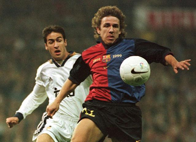 F.C. Barcelona's Carlos Puyol, foreground, controls the ball ahead of Real Madrid's Raul Gonzalez during a Spanish league soccer match in Madrid Saturday, February 26, 2000. Real won the match 3-0. (AP Photo/Ruben Mondelo)