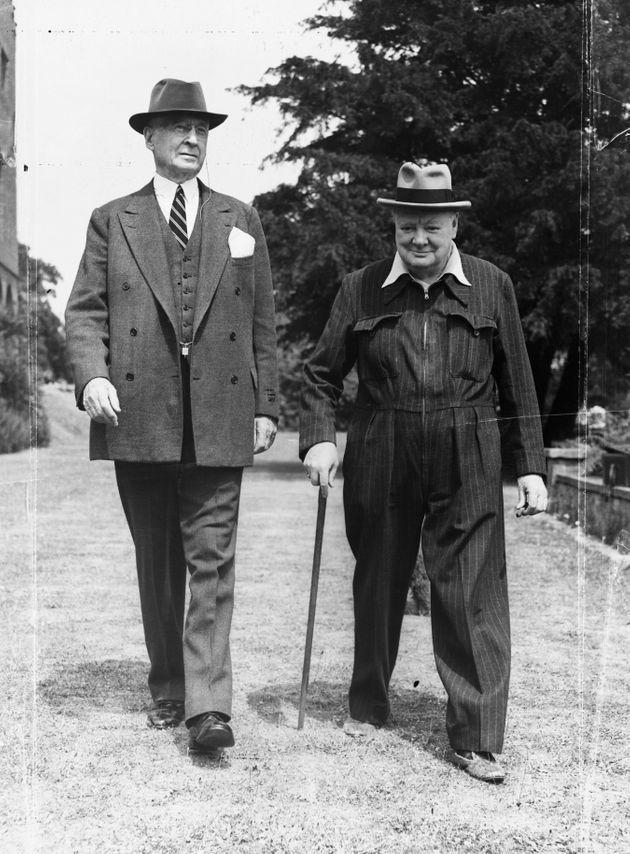Churchill walks with the American financier and Presidential advisor Bernard Baruch on the grounds of his Kent home in July 1949. (Photo: Hulton Deutsch via Getty Images)