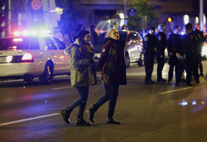 <p>Demonstrators leave the area after being ordered to disperse by police following a protest against President-elect Donald Trump in downtown Indianapolis on Saturday, Nov. 12, 2016. (AP Photo/AJ Mast) </p>