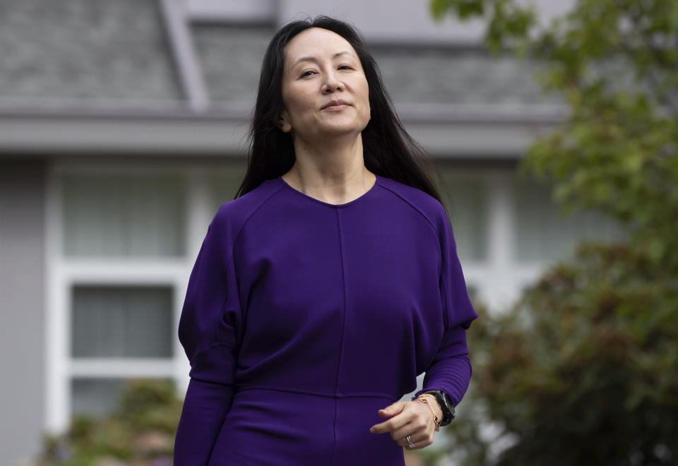 Meng Wanzhou, chief financial officer of Huawei, leaves home to attend what is expected to be the final day of her extradition hearing at B.C. Supreme Court, in Vancouver, on Wednesday, Aug. 18, 2021. (Darryl Dyck/The Canadian Press via AP)