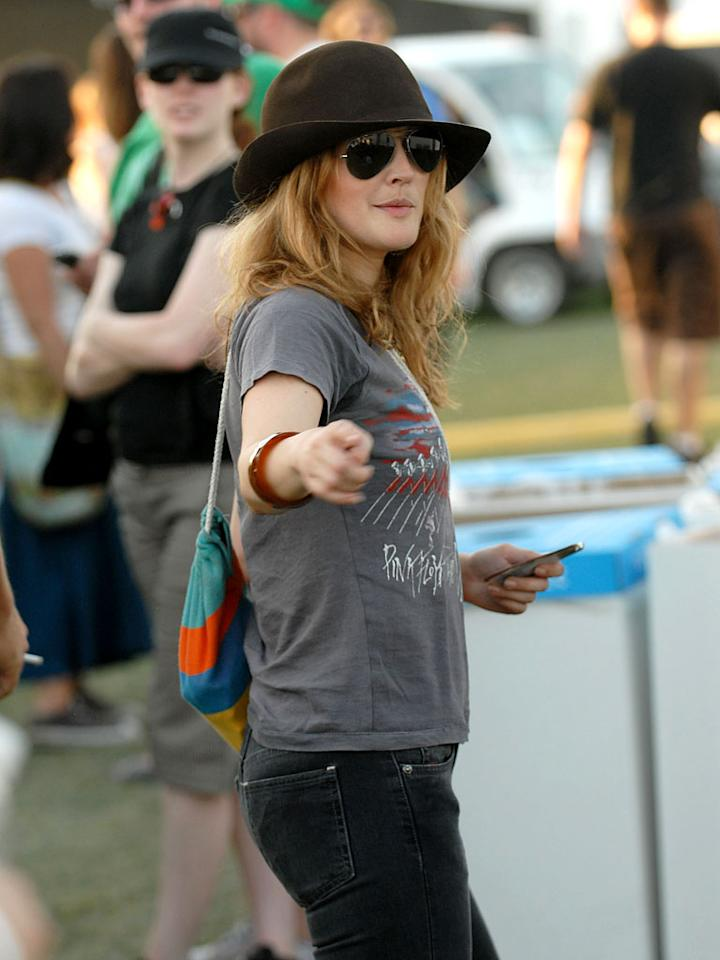 "Drew Barrymore tries to go incognito at Coachella. Kevin Mazur/<a href=""http://www.wireimage.com"" target=""new"">WireImage.com</a> - April 27, 2007"