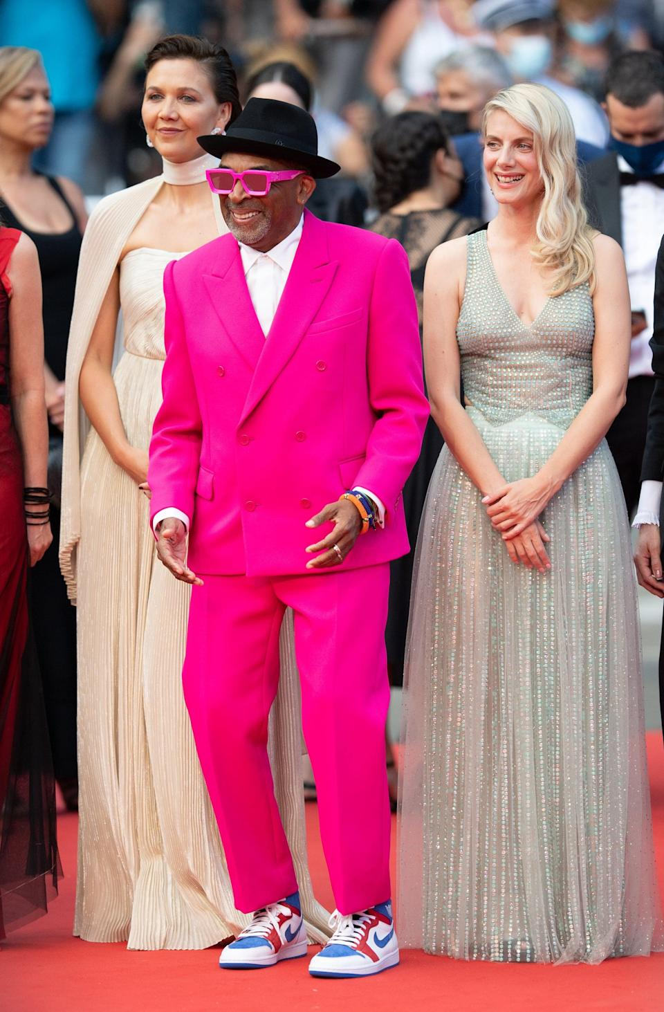 <p>Wearing a pink Louis Vuitton suit with Nikes.</p>