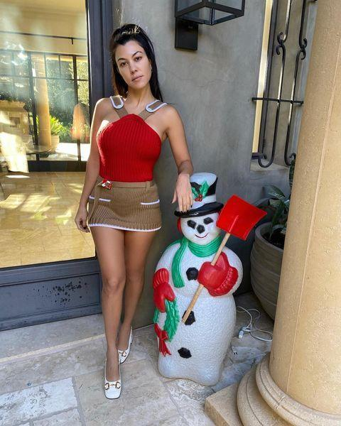 """<p>It may be """"just the family"""" coming over for Christmas Eve dinner, but that doesn't mean Kourtney's going to put in any less effort on her outfit or decor!</p>"""