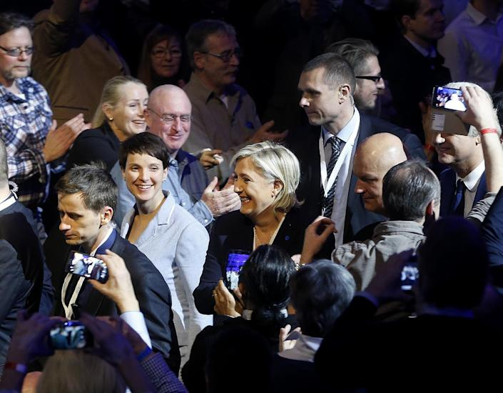 AfD (Alternative for Germany) chairwoman Frauke Petry, left, and Far-right leader and candidate for next spring presidential elections Marine le Pen from France enter the room at the beginning of a meeting of European Nationalists in Koblenz, Germany, Saturday, Jan. 21, 2017. (AP Photo/Michael Probst)