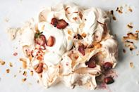 "Serve this giant, whipped-cream-and-mezcal-soaked-berry-topped meringue on a single platter, in the center of the table—just give everyone a spoon and let them dig in. <a href=""https://www.epicurious.com/recipes/food/views/giant-meringue-pavlova-gigantata?mbid=synd_yahoo_rss"" rel=""nofollow noopener"" target=""_blank"" data-ylk=""slk:See recipe."" class=""link rapid-noclick-resp"">See recipe.</a>"