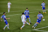 Real Madrid's Eden Hazard, center, tries a shot during the Spanish La Liga soccer match between Alaves and Real Madrid at Mendizorroza stadium in Vitoria, Spain, Saturday, Jan. 23, 2021. (AP Photo/Alvaro Barrientos)