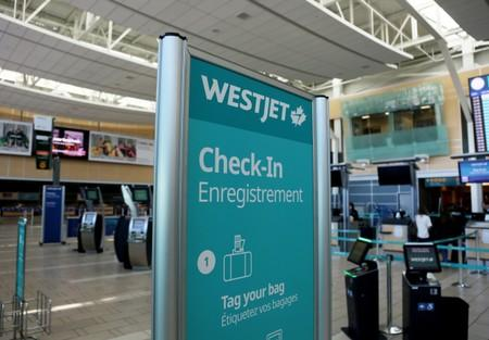 WestJet airline signage is pictured at Vancouver's international airport in Richmond